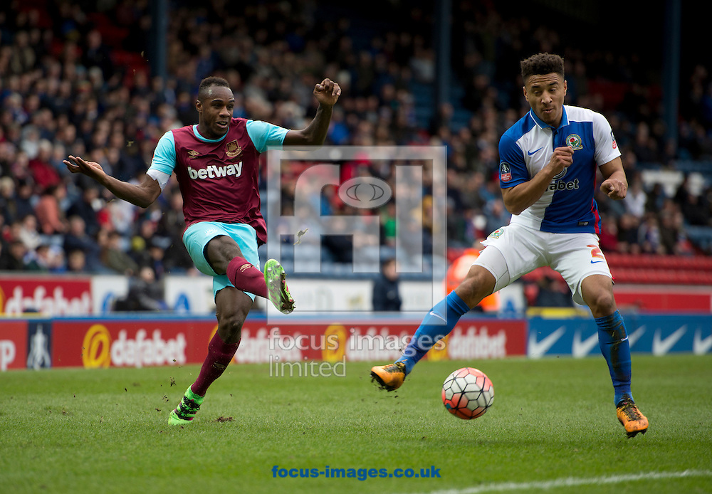 Emmanuel Emenike of West Ham United (left) plays the ball as Adam Henley of Blackburn Rovers closes down during the FA Cup match at Ewood Park, Blackburn<br /> Picture by Russell Hart/Focus Images Ltd 07791 688 420<br /> 21/02/2016