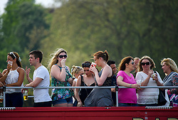 © London News Pictures. 12/05/2016. Windsor, UK. People enjoy the sunshine from the rooftop of an open bar on the first day of the 2016 Royal Windsor Horse Show, held in the grounds of Windsor Castle in Berkshire, England. The opening day of the event was cancelled due to heavy rain and waterlogged grounds. This years event is part of HRH Queen Elizabeth II's 90th birthday celebrations.  Photo credit: Ben Cawthra/LNP