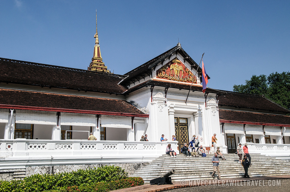 Tourists milling on the stairs of the main palace building in the Royal Palace Museum of Luang Prabang, Laos.