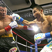 """Kanat """"QazaQ"""" Islam of Almaty, Kazakhstan (R) beats Noroberto """"Demonio"""" Gonzalez of Monterrey, Mexico to win the NABO Jr. Middle Weight Title during a Nelsons Promotions boxing match at the Boca Raton Resort  and Club on Friday, May 26, 2017 in Boca Raton, Florida.  (Alex Menendez via AP)"""