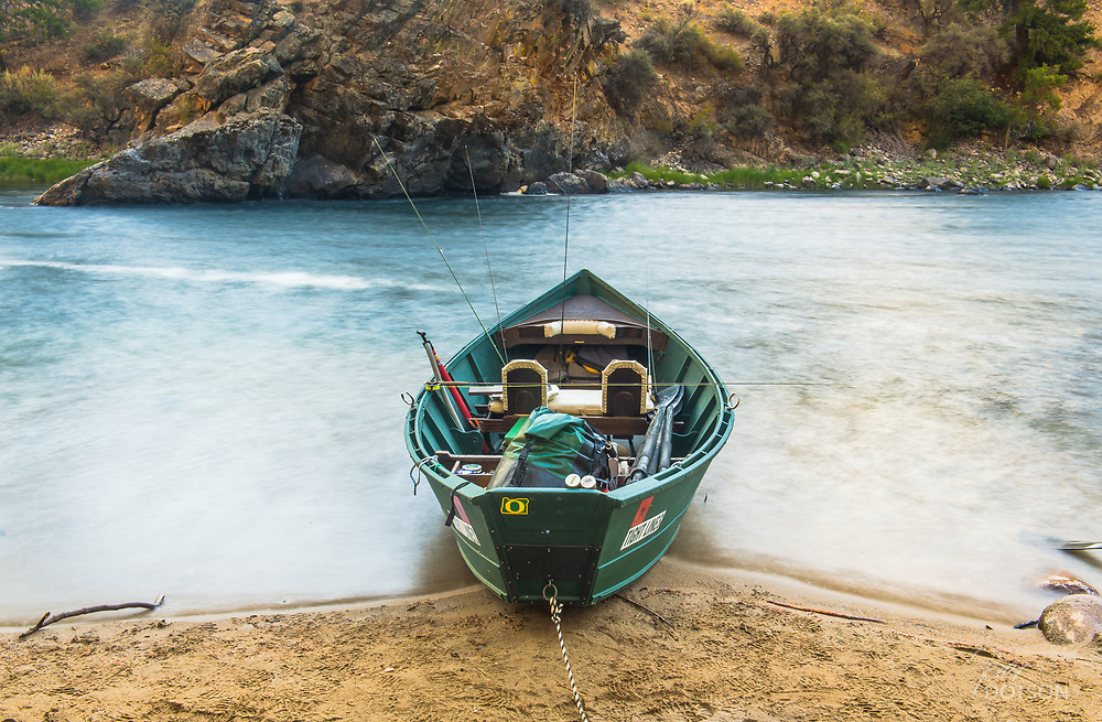 Published in TFFJ Issue 8.2 - A MaKenzie Drift Boat with a proud Oregon Duck owner tucked away after a long day of floating the Middle Fork of the Salmon River in central Idaho.