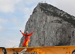 © Licensed to London News Pictures. 11/10/2014. Gibraltar, UK Wheelchair bound grandfather Tom Lackey, 94, the world's oldest 'wing-walker', stands on a two-seater plane during his flight around Gibraltar's Rock on October 11, 2014. He set a world record by becoming the first person to wingwalk from Land's End to the Isles of Scilly earlier in the year. Photo credit : Anselmo Torres/LNP