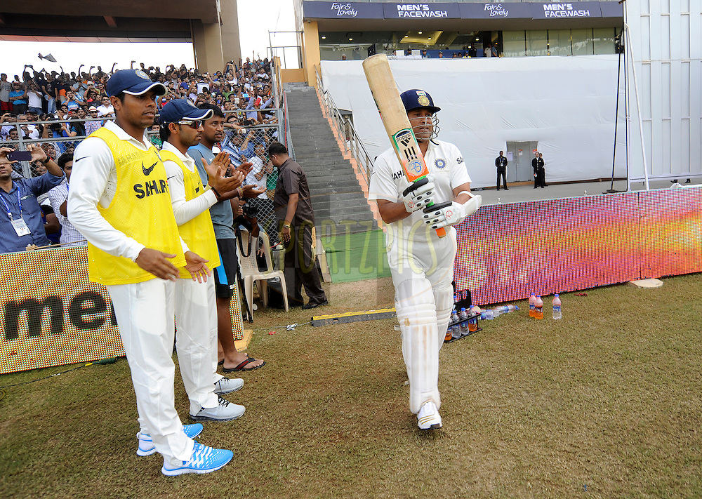 Sachin Tendulkar of India walks to bat during day one of the second Star Sports test match between India and The West Indies held at The Wankhede Stadium in Mumbai, India on the 14th November 2013<br /> <br /> This test match is the 200th test match for Sachin Tendulkar and his last for India.  After a career spanning more than 24yrs Sachin is retiring from cricket and this test match is his last appearance on the field of play.<br /> <br /> Photo by: Pal PIllai - BCCI - SPORTZPICS<br /> <br /> Use of this image is subject to the terms and conditions as outlined by the BCCI. These terms can be found by following this link:<br /> <br /> http://sportzpics.photoshelter.com/gallery/BCCI-Image-Terms/G0000ahUVIIEBQ84/C0000whs75.ajndY