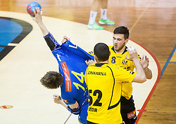 Sebastian Skube of Celje PL between Marko Ostir of Gorenje and Senjamin Buric of Gorenje during handball match between RK Gorenje Velenje and RK Celje Pivovarna Lasko in Final match of 1st NLB League - Slovenian Championship 2013/14 on May 23, 2014 in Rdeca dvorana, Velenje, Slovenia. Photo by Vid Ponikvar / Sportida