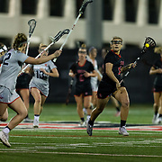 23 March 2018: San Diego State Aztecs midfielder Morgan Taylor brings the ball down the field in the first half. The Aztecs beat the Lady Flames 11-10 Friday night. <br /> More game action at sdsuaztecphotos.com