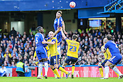 Chelsea's Gary Cahill jumps to head a cross during the The FA Cup third round match between Chelsea and Scunthorpe United at Stamford Bridge, London, England on 10 January 2016. Photo by Shane Healey.