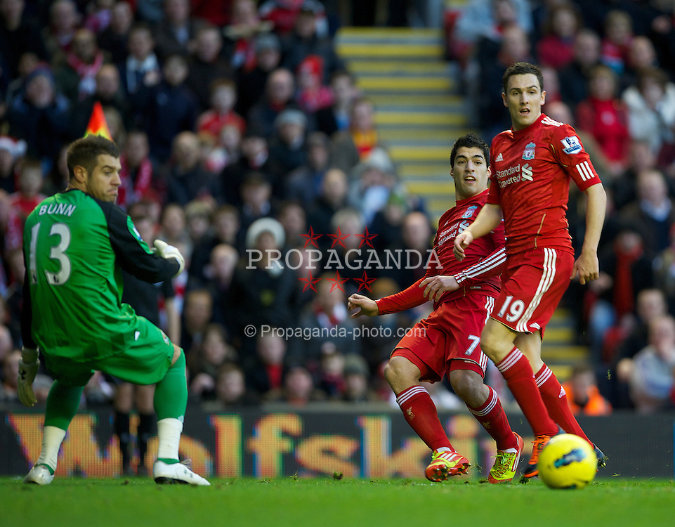 LIVERPOOL, ENGLAND - Boxing Day Monday, December 26, 2011: Liverpool's Luis Alberto Suarez Diaz and Stewart Downing in action against Blackburn Rovers during the Premiership match at Anfield. (Pic by David Rawcliffe/Propaganda)
