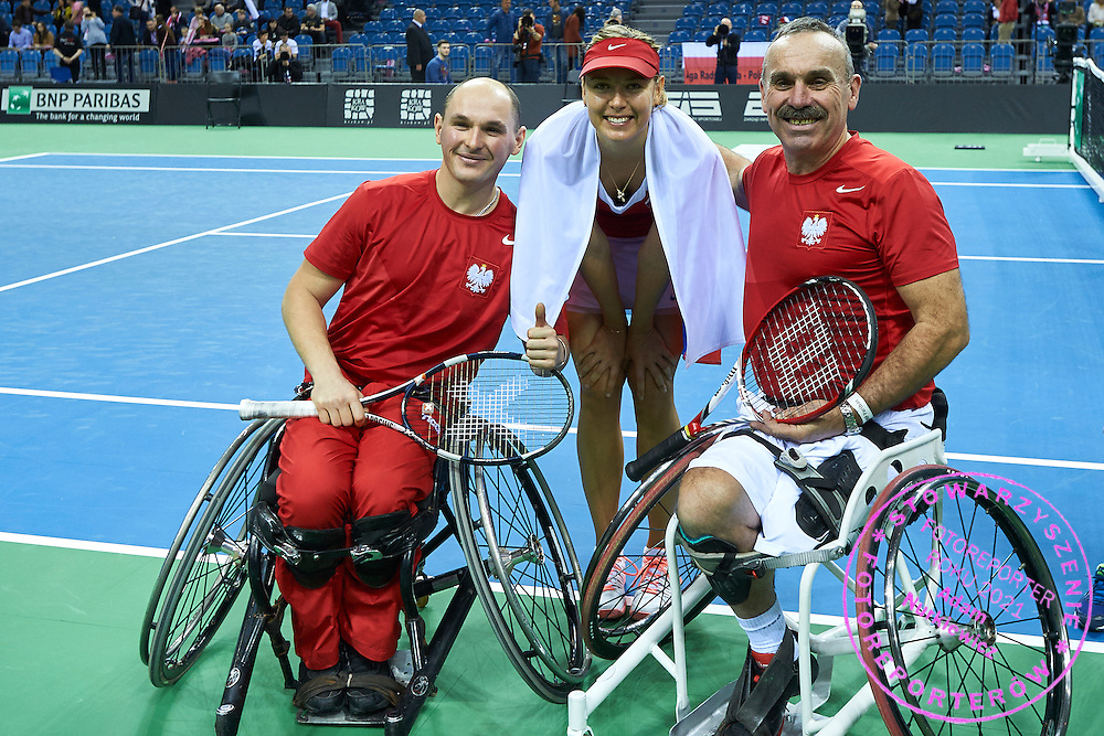 (C) Maria Sharapova from Russia poses with disability tennis players during Second Day of the Fed Cup / World Group 1st round tennis match between Poland and Russia at Tauron Krakow Arena on February 8, 2015 in Cracow, Poland.<br /> <br /> Poland, Cracow, February 8, 2015<br /> <br /> Picture also available in RAW (NEF) or TIFF format on special request.<br /> <br /> For editorial use only. Any commercial or promotional use requires permission.<br /> <br /> Adam Nurkiewicz declares that he has no rights to the image of people at the photographs of his authorship.<br /> <br /> Mandatory credit:<br /> Photo by &copy; Adam Nurkiewicz / Mediasport
