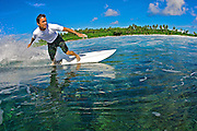 Scott Clephane surfing in the Maldives