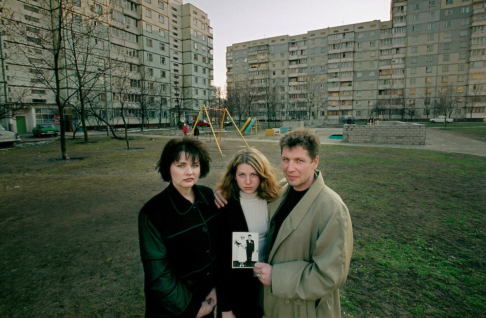 Ukraine 2001...Iryna, Katja and Sergej Lobanov infront of their house in Charkivsky. Iryna was pregnant with Katja at the time of the accident in Chernobyl...Photo: Markus Marcetic/MOMENT