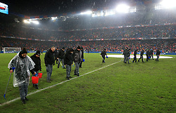 Ground staff tend to the pitch at half-time during the FIFA World Cup Qualifying second leg match at St Jakob Park, Basel.