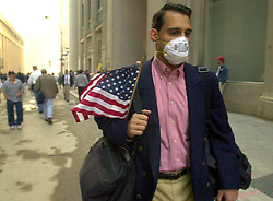 Sep 17, 2001; New York, New York, U.S.; Carrying an American flag PETER VOSS heads to work in the financial district of New York, NY Monday Sept. 17, 2001. The New York Stock Exchange opened today for the first time after the World Trade Center attack. (Credit Image: © Edward A. Ornelas/San Antonio Express-News/ZUMApress.com)