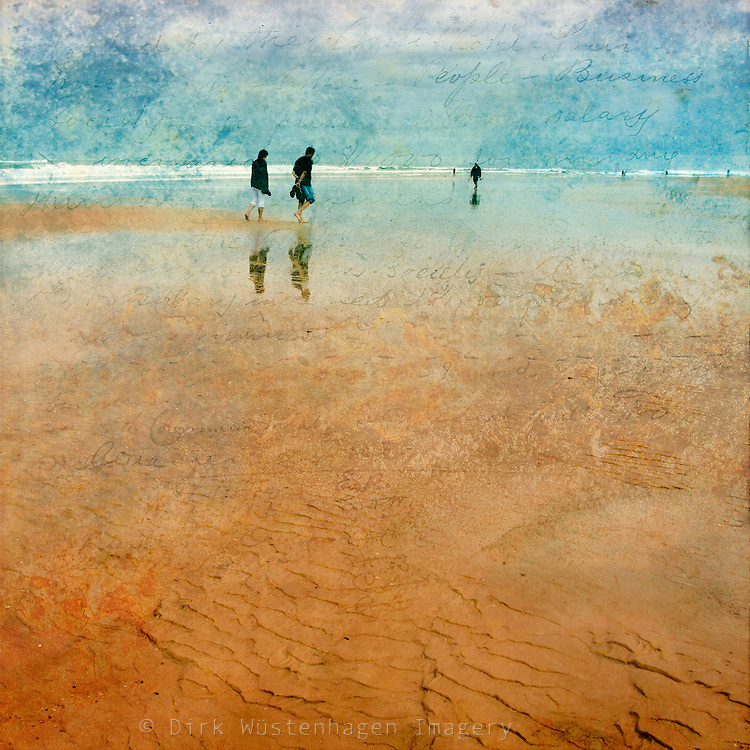 Low angle view of people walking on the beach at low tide. Textured photograph<br />