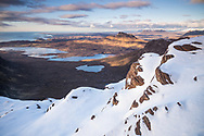"Taken from the top of Sgurr An Fhidhleir (""The Fiddler"") at sunset looking north out across Loch Bad A Ghail and Stac Pollaidh in the distance."