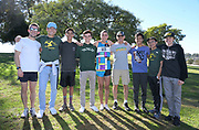 Dec 8, 2018; Balboa Park, CA, USA; Will Frankenfeld aka William Frankenfeld of Long Beach Poly (Calif.), center,  poses with coach Mike Fillipow and teammates after placing 14th in the boys race in 15:52.4 during the 40th Foot Locker cross country championships at Morley Field.