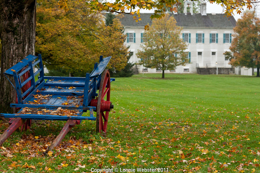 Blue cart with red wheels are part of Fall scene at Shaker Village in Mercer County KY