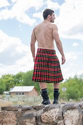 hot muscular man in a kilt outdoors