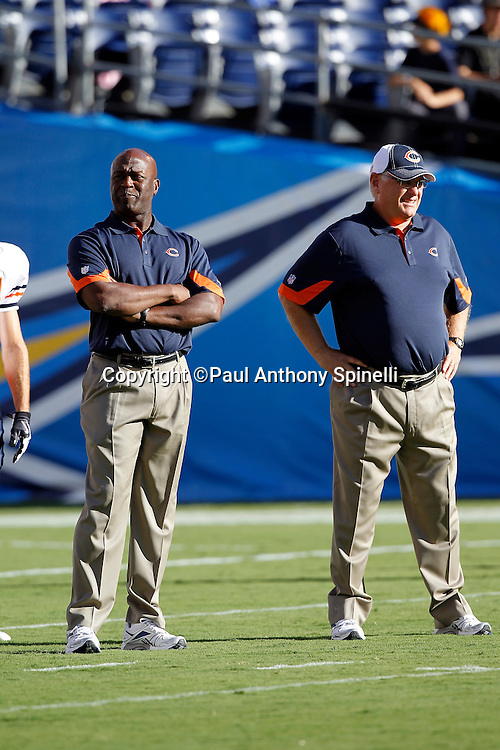 Chicago Bears Head Coach Lovie Smith (left) and Offensive Coordinator Mike Martz watch pregame warmups during a NFL week 1 preseason football game against the San Diego Chargers, Saturday, August 14, 2010 in San Diego, California. The Chargers won the game 25-10. (©Paul Anthony Spinelli)