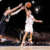 15 July 2012: Rudy Fernandez of Team Spain grabs the loose ball against Nando De Colo of Team France during a pre-Olympic exhibition game won 75-70 by Spain over France, at the Palais Omnisports de Paris Bercy, in Paris, France.