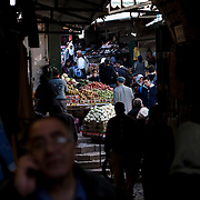 (03/14/2011 JERUSALEM) Fruits, vegetables, meats and other goods are sold inside the Christian Quarter's market at Jerusalem's Old City.  The Christian Quarter is also the home of the Church of the Holy Sepulchre where Jesus Christ is believed to have been crucified, laid to rest in a tomb and also rose from the dead.   [WILLIE J. ALLEN JR.]