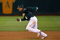 June 28, 2011; Oakland, CA, USA; Oakland Athletics center fielder Coco Crisp (4) runs to second base against the Florida Marlins during the sixth inning at the O.co Coliseum.  Oakland defeated Florida 1-0.