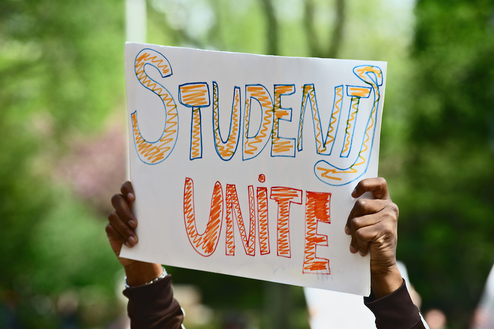 "Hand-made sign reading ""Students Unite"" at rally against tuition increase at Brooklyn College, Brooklyn, New York"