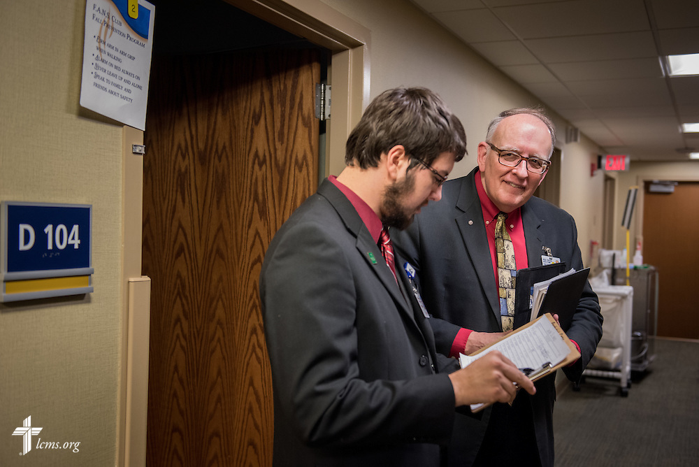 Seminarian Jacob Berlinski of Concordia Seminary, St. Louis, and the Rev. Doug Nicely (rear), chaplain at Memorial Hospital in Belleville, Ill., chat outside a patient's room on Wednesday, Jan. 14, 2015. LCMS Communications/Erik M. Lunsford