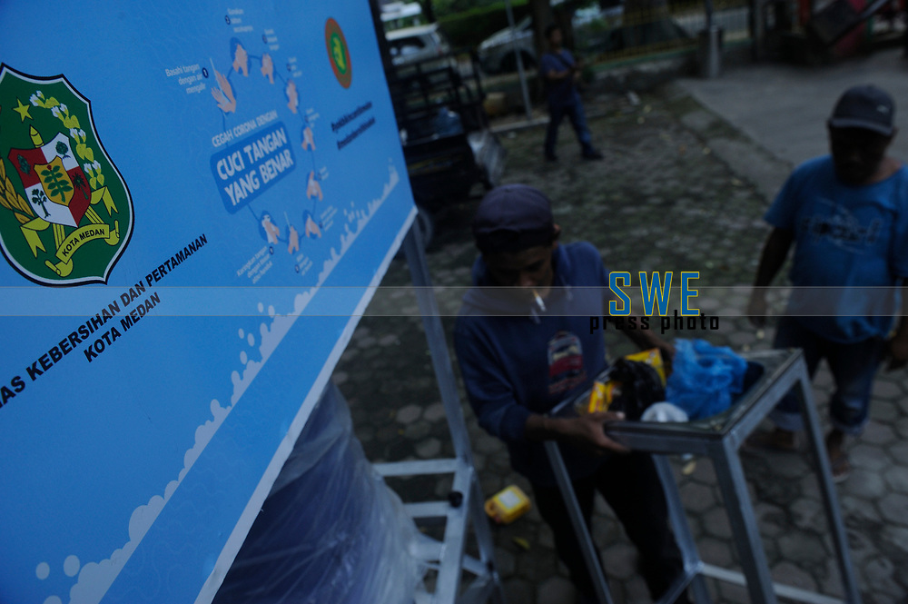 Medan, Indonesia, March 25, 2020: A water seller activity beside the silent main roads of Medan city in North Sumatra province, Indonesia as humanity dailylife during warning of the spread of Corona Virus Disease (COVID) 19 in Medan, Indonesia on March 25, 2020.