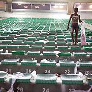 A  young Brazilian girl collects used drink cans after the Fluminense V Sao Paulo, Futebol Brasileirao  League match at the Jornalista Mário Filho, Maracana Stadium, Rio de Janeiro,  Brazil. 29th August 2010. Photo Tim Clayton.