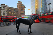 The Black Horse, black marble sculpture, 2005, by Mark Wallinger, b. 1959, exhibited as part of Sculpture in the City 2017, an annual public art programme, July 2017, City of London, London, England. The horse sculpture was made by scanning a live racehorse. Picture by Manuel Cohen