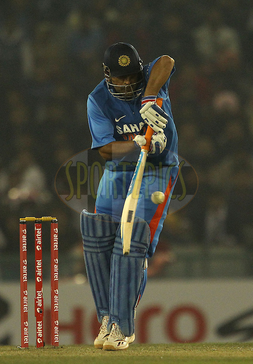MS Dhoni of India during the 4th Airtel ODI Match between India and England held at the PCA Stadium, Mohal, India on the 23rd January 2013..Photo by Ron Gaunt/BCCI/SPORTZPICS ..Use of this image is subject to the terms and conditions as outlined by the BCCI. These terms can be found by following this link:..http://www.sportzpics.co.za/image/I0000SoRagM2cIEc