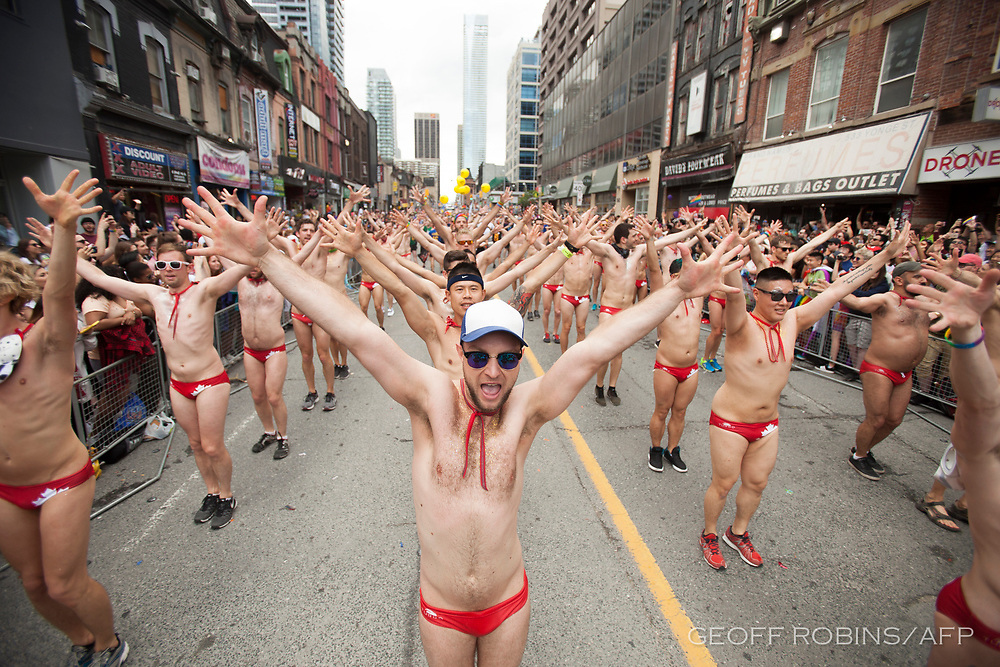 A group of men dance during the Pride Parade in Toronto, Ontario, June 25, 2017