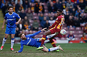 Gillingham midfielder Scott Wagstaff flies into a challenge with Omari Patrick of Bradford City during the EFL Sky Bet League 1 match between Bradford City and Gillingham at the Northern Commercials Stadium, Bradford, England on 24 March 2018. Picture by Paul Thompson.