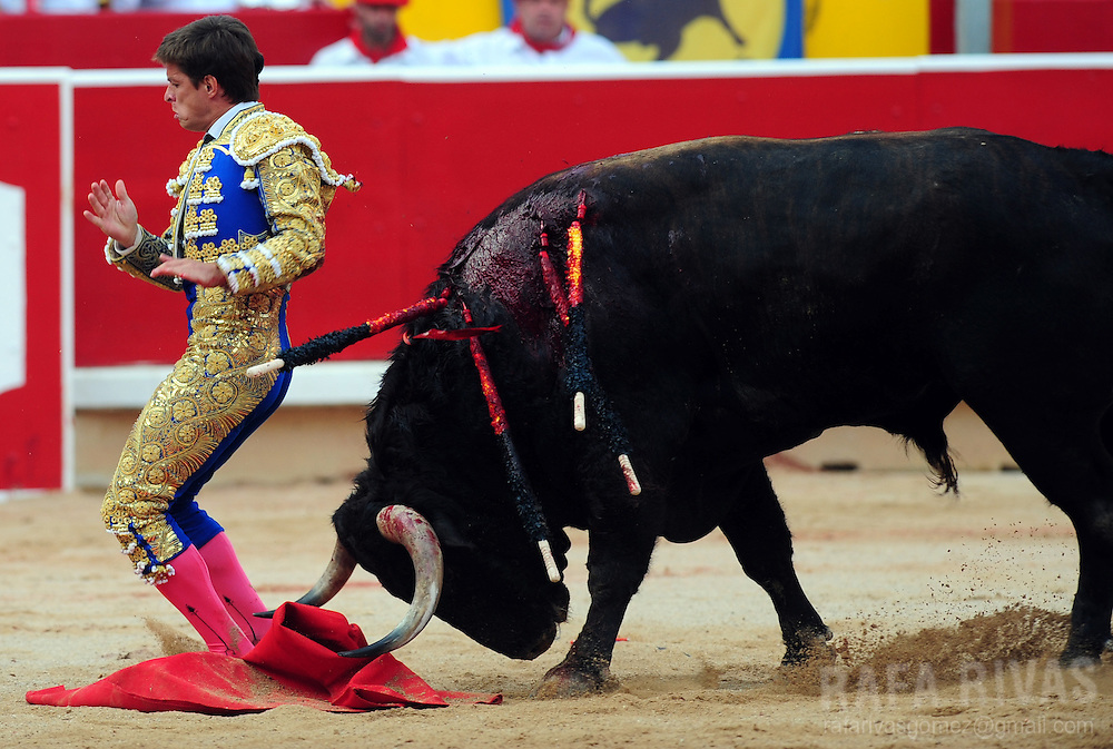 Spanish matador El Juli is gored as he fights a fighting bull during a corrida at the bull-ring of Pamplona, North of Spain, on July 12, 2010, during the San Fermin festival. Photo Rafa Rivas