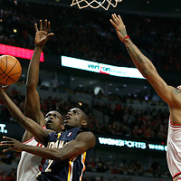 16 April 2011: Indiana Pacers point guard Darren Collison (2) goes for the layup against Chicago Bulls small forward Luol Deng (9) and Chicago Bulls point guard Derrick Rose (1) during the Chicago Bulls 104-99 victory over the Indiana Pacers, during the game 1 of the Eastern Conference first round at the United Center, Chicago, Illinois, USA.
