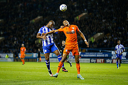 Claude Dielna of Sheffield Wednesday and Tyrone Mings of Ipswich compete in the air - Photo mandatory by-line: Rogan Thomson/JMP - 07966 386802 - 30/09/2014 - SPORT - FOOTBALL - Sheffield, England - Hillsborough Stadium - Sheffield Wednesday v Ipswich Town - Sky Bet Championship.