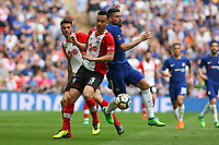 Football - 2017 / 2018 FA Cup - Semi Final: Chelsea vs. Southampton<br /> <br /> Southampton's Maya Yoshida stops Olivier Giroud of Chelsea at Wembley Stadium <br /> <br /> COLORSPORT/SHAUN BOGGUST