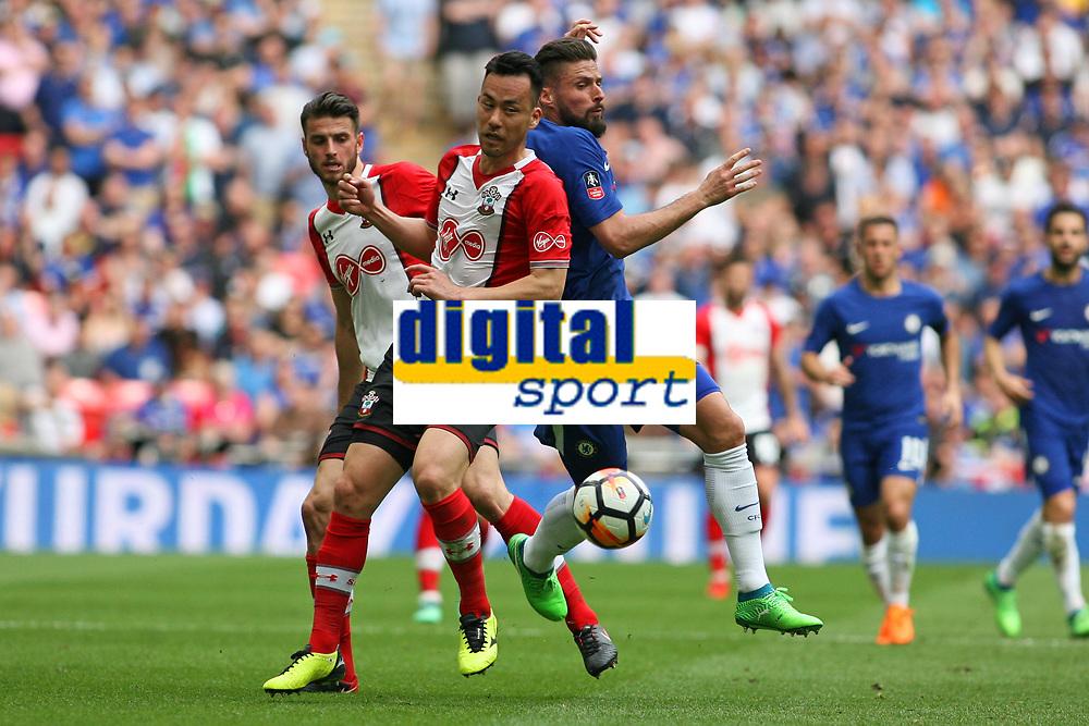 Football - 2017 / 2018 FA Cup - Semi Final: Chelsea vs. Southampton<br /> <br /> Southampton's Maya Yoshida stops Olivier Giroud of Chelsea at Wembley Stadium <br /> <br /> COLORSPORT/SHAUN BOGGUST