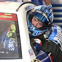 Sprint Cup Series driver Jimmie Johnson (48) enters his car during the 57th Annual NASCAR Coke Zero 400 practice session at Daytona International Speedway on Friday, July 3, 2015 in Daytona Beach, Florida.  (AP Photo/Alex Menendez)