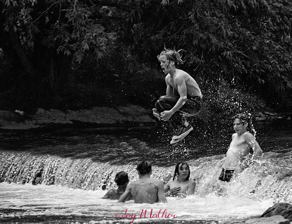 A group of boys frolic in Bear Creek in the Lakewood, CO area, summer 1974.