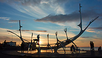 "Silhouette of Sun Voyager (Sólfar) at Sunset. Form wikipedia ""Sun Voyager is a dreamboat, an ode to the sun. Intrinsically, it contains within itself the promise of undiscovered territory, a dream of hope, progress and freedom."" Image taken with a Nikon 1 V2 camera and 10 mm f/2.8 lens (ISO 160, 10 mm, f/8, 1/400 sec). Nikonians Photo Adventure with Mike Hagen."