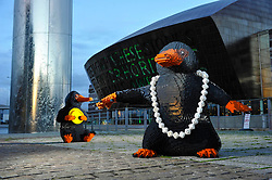 EDITORIAL USE ONLY Two LEGO brick Nifflers, which are fan-favourite creatures from the new J.K. Rowling film Fantastic Beasts: The Crimes of Grindelwald, appear in Cardiff Bay to celebrate LEGO Group's new range of Wizarding World play sets, Wales.