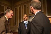 Ohio University President Roderick McDavis speaks with Dr. Thomas Carpenter, the previous recipient of the Distinguished Professor Award, and the current recipient, Dr. Christopher France at the conclusion of the ceremony, held in Baker University Center Ballroom on Tuesday, March 10.