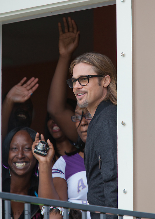 "Brad Pitt with residents in their home in the"" Make it Right "" housing project he developed in New Orleans Lower 9th Ward the day before a star-studded gala being held in New Orleans."