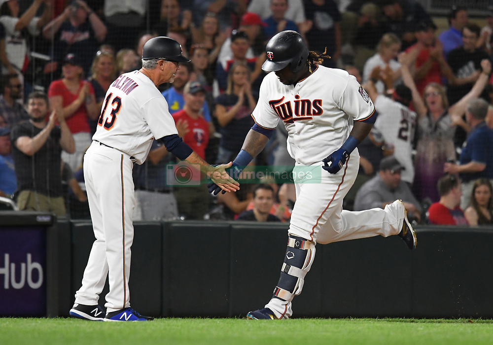 May 31, 2018 - Minneapolis, MN, U.S. - MINNEAPOLIS, MN - MAY 31: Minnesota Twins Third base Miguel Sano (22) low-fives Minnesota Twins Third base coach Gene Glynn (13) as he rounds the bases after hitting a 3-run home run in the bottom of the 7th during a MLB game between the Minnesota Twins and Cleveland Indians on May 31, 2018 at Target Field in Minneapolis, MN. The Indians defeated the Twins 9-8.(Photo by Nick Wosika/Icon Sportswire) (Credit Image: © Nick Wosika/Icon SMI via ZUMA Press)