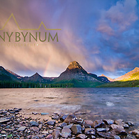 summer storm clouds over two med lake and sinopah, crown of the continent, glacier national park, monana, usa