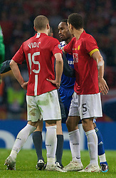 MOSCOW, RUSSIA - Wednesday, May 21, 2008: Manchester United's Rio Ferdinand steps in to prevent Nemanja Vidic from attacking Didier Drogba during the UEFA Champions League Final at the Luzhniki Stadium. (Photo by David Rawcliffe/Propaganda)