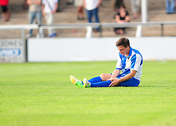 Bristol Rovers' Fabian Broghammer clutches onto his injured leg - Photo mandatory by-line: Dougie Allward/JMP - Tel: Mobile: 07966 386802 16/07/2013 - SPORT - FOOTBALL - Bristol -  Hereford United V Bristol Rovers - Pre Season Friendly