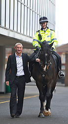 LIVERPOOL, ENGLAND - Monday, April 4, 2011: Liverpool's legendary number nine Ian Rush pictured at Anfield with Jaguar the Merseyside Police Horse Number Nine ridden by Sergeant Sarah Hamilton. Jaguar will be leading the winning horse to the winner's circle on Saturday at the John Smith's Aintree Grand National. (Photo by David Rawcliffe/Propaganda)