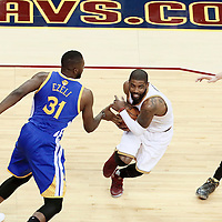 10 June 2016: Cleveland Cavaliers guard Kyrie Irving (2) drives past Golden State Warriors center Festus Ezeli (31) during the Golden State Warriors 108-97 victory over the Cleveland Cavaliers, during Game Four of the 2016 NBA Finals at the Quicken Loans Arena, Cleveland, Ohio, USA.